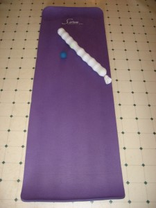 yoga mat with tennis ball roller